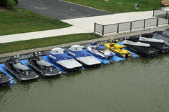Jet skis parked at walkway Stock Photo