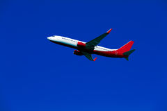 Jet in sky Stock Photography