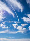 Jet smoke and blue sky. Jet smoke and deep blue sky with white clouds Royalty Free Stock Photo