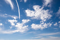 Jet smoke and blue sky. Jet smoke and deep blue sky with white clouds Stock Photos