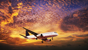 Jet in a sunset sky Royalty Free Stock Images