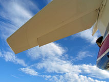 Jet tail. Private jet aircraft tail surfaces framed by clouds and sky Stock Photography