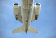 Jet Tail Section. Jet flying overhead for a landing to any destination Royalty Free Stock Images