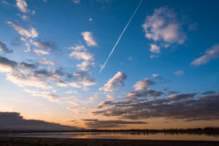 Jet Trail At Sunset foto de stock royalty free