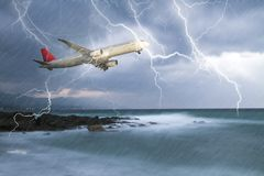 Jet travelling through rainy stormy sky Royalty Free Stock Images