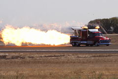 Jet Truck. A fire spewing jet truck performs at an airshow stock photos