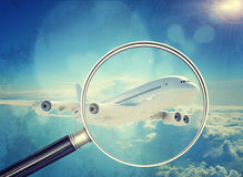 Jet under magnifier, close-up view Stock Image