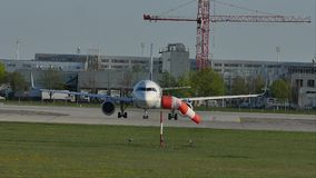 Plane waiting to takeoff from Munich Airport, MUC, spring. Jet waiting on runway, Munich Airport, MUC stock video footage