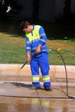 Jet washing pavement, Malaga. Royalty Free Stock Image
