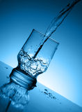Jet of water. Filling by water of a glass glass Royalty Free Stock Images