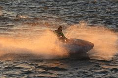 Jet watercraft skims across the waves Stock Photo