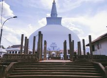 Jetavanaramaya of Sri Lanka. The biggest stupa in Sri Lanka,I took this picture at noon,the ground is very hot,and we can't wear shoes stock photography