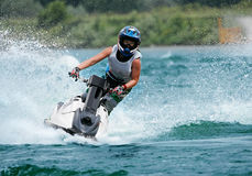 Jetbike. Rushes on waves with big speed so sparks fly Royalty Free Stock Images