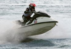 Jetbike. Rushes on waves with big speed so sparks fly Stock Images