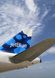 JetBlue Airbus A320 blueberries-inspired design tailfin  at Owen Roberts International Airport at Grand Cayman. GRAND CAYMAN, CAYMAN ISLANDS - June 13: JetBlue Royalty Free Stock Photo