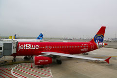 JetBlue Airbus A320 Honoring the brave men and women Fire Department City of NY at the gate at the Terminal 5 at JFK Stock Image