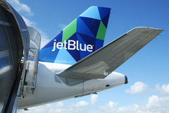 JetBlue Airbus A321 prism inspired design tailfin. PUNTA CANA, DOMINICAN REPUBLIC - JANUARY 4, 2016: JetBlue Airbus A321 prism inspired design tailfin at Punta Stock Images