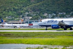 Montego Bay, Jamaica - April 11 2015: JetBlue aircraft on the runway at Sangster International Airport MBJ in Montego Bay royalty free stock photos