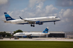 A Jetblue Airlines Embraer 190 aircraft landing Stock Photography