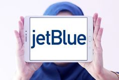 JetBlue Airways Corporation logo. Logo of JetBlue Airways Corporation on samsung tablet holded by arab muslim woman. jetBlue is an American airline headquartered Royalty Free Stock Photography