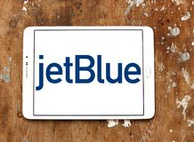 JetBlue Airways Corporation logo. Logo of JetBlue Airways Corporation on samsung tablet. jetBlue is an American airline headquartered in New York City Royalty Free Stock Photos