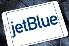 JetBlue Airways Corporation logo. Logo of JetBlue Airways Corporation on samsung tablet. jetBlue is an American airline headquartered in New York City Stock Image