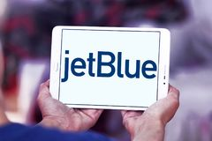 JetBlue Airways Corporation logo. Logo of JetBlue Airways Corporation on samsung tablet. jetBlue is an American airline headquartered in New York City Royalty Free Stock Photo