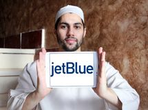JetBlue Airways Corporation logo. Logo of JetBlue Airways Corporation on samsung tablet holded by arab muslim man. jetBlue is an American airline headquartered Stock Image