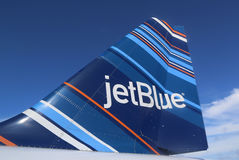 JetBlue Embraer 190 barcode-inspired design tailfin. TRUE BLUE, GRENADA - JUNE 13, 2017: JetBlue Embraer 190 barcode-inspired design tailfin at Maurice Bishop Royalty Free Stock Image