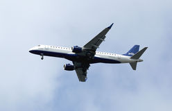 JetBlue Embraer 190 in New York sky before landing Royalty Free Stock Photo