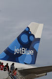 JetBlue plane on tarmac at Maurice Bishop International Airport in Grenada Stock Photos