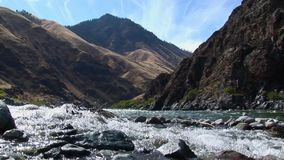 Jetboats on Hells Canyon Snake River Idaho. Hells Canyon Snake River Idaho - Mtns.4 stock video footage