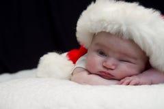 Jeter un coup d'oeil la chéri Santa Photo libre de droits