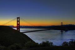 jetez un pont sur le lever de soleil d'or de porte Images libres de droits