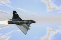Jetfighter. A jetfighter armed with rockets in use Royalty Free Stock Photo
