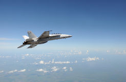 Jetfighter in flight. Modern Air force jet fighter at high altitude Stock Images