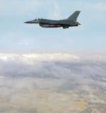 Jetfighter in flight. Modern fighter jet at high altitude Stock Photos