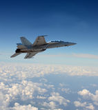Jetfighter in flight. Modern navy jetfighter at high altitude Royalty Free Stock Photography