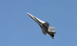 Jetfighter at high speed. Modern Navy jetfighter climbing at high speed Royalty Free Stock Photo