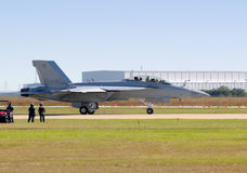 Jetfighter side view. US Navy jetfighter taxiing on the ground Royalty Free Stock Images