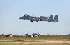 Jetfighter takeoff. Air Force military jet fighter taking off Royalty Free Stock Image
