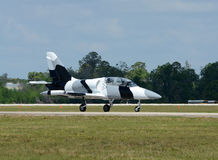 Jetfighter taxiing. Jetfighter in camouflage colors taxiing on the ground Stock Photos