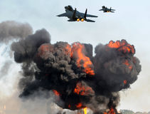 Jetfighters in attack. Aerial bombardment by two fighter jets Royalty Free Stock Image