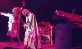 1974. Jethro Tull 04. Denmark, Copenhagen. The picture shows Martin Barre playing on his guitar and Ian Anderson dancing around the stage Royalty Free Stock Photo
