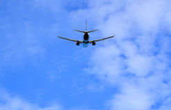 Jetliner aircraft on flight, partly cloudy sky Royalty Free Stock Photography