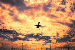 Jetliner aircraft on flight at sunset, dramatic sky Royalty Free Stock Photography