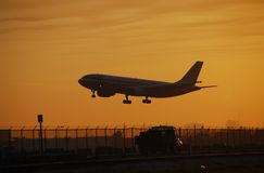 Jetliner landing at dawn Stock Photos