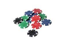 Jetons de poker dispersés Photographie stock libre de droits