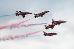 Jets de T1 de faucon sur la fin de salon de l'aéronautique  Image libre de droits
