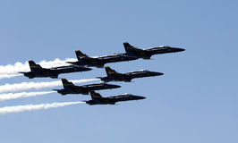 Jets flying in formation. Over Lake Washington Royalty Free Stock Photo